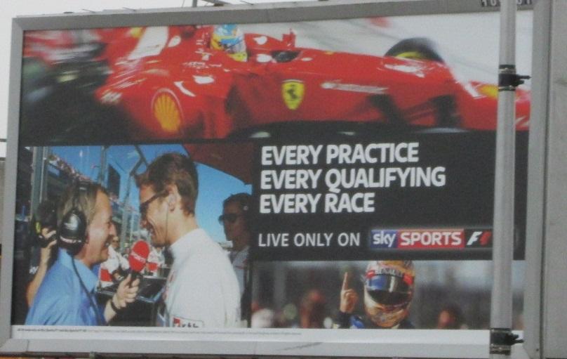 Sky Sports F1's billboard advertising in the run-up to the 2013 Formula One season. Top: Fernando Alonso; Bottom Left: Martin Brundle interviews Jenson Button in Australia 2012; Bottom Right: Sebastian Vettel.