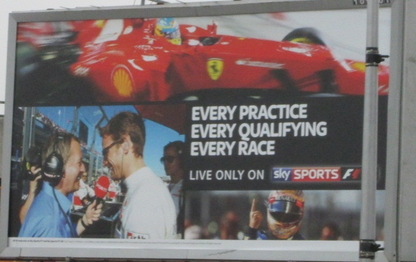 Sky Sports F1's billboard advertising in the run-up to the 2013 Formula One season. Top: Fernando Alonso; Bottom Left: Martin Brundle interviews Jenson Button in Australia 2012; Bottom Right: Sebastian Vettel.